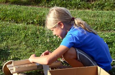Kacenka working on a cart.