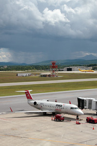 CRJ getting ready for the flight to Detroit. Storms and Camels Hump in the background.