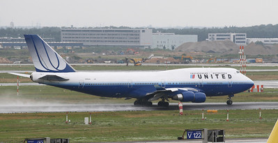 UAL 744 on a take off. Frankfurt airport visitors terrace on a rainy morning.