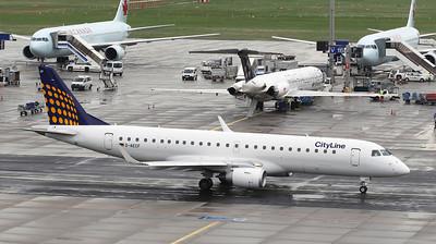 Lufthansa Embraer ERJ 190. Frankfurt airport visitors terrace on a rainy morning.
