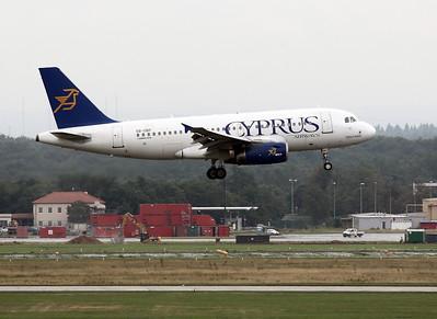 Cyprus A319 landing. Frankfurt airport visitors terrace on a rainy morning.