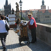 """Prague - Charles Bridge.  This Calliope Player (complete with mechanical Monkey) was another of the entertainers I encountered.  Whenever someone would provide a """"donation"""", he'd give them a """"tip of the hat""""."""