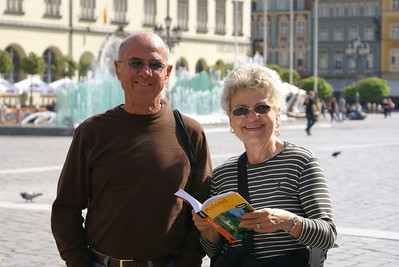 """My parents in Wroclaw's square.  That's Fodor's """"Poland"""" book in my mom's hand.  Don't buy it."""