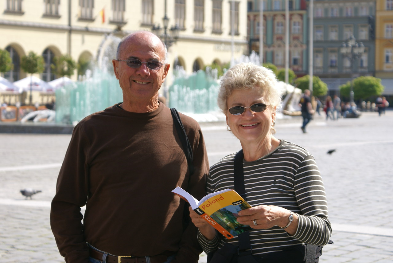 "My parents in Wroclaw's square.  That's Fodor's ""Poland"" book in my mom's hand.  Don't buy it."