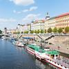 Characteristic architecture and tourist boats alongside promenade