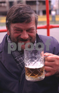 A worker toasts a Pilsner beer during his noon lunch break.