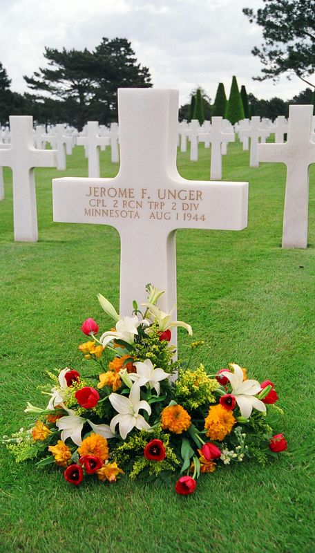 A soldier from Minnesota, killed in August, near the end of the Normandy campaign. We never saw anyone leaving flowers but many graves were so honored.