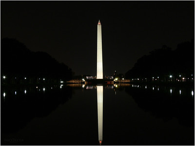 The pool at the Washington Mall reflects the 555 ft tall obelisk.