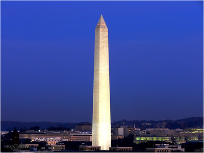 The Washington Monument looms in the twilight before darkness falls.
