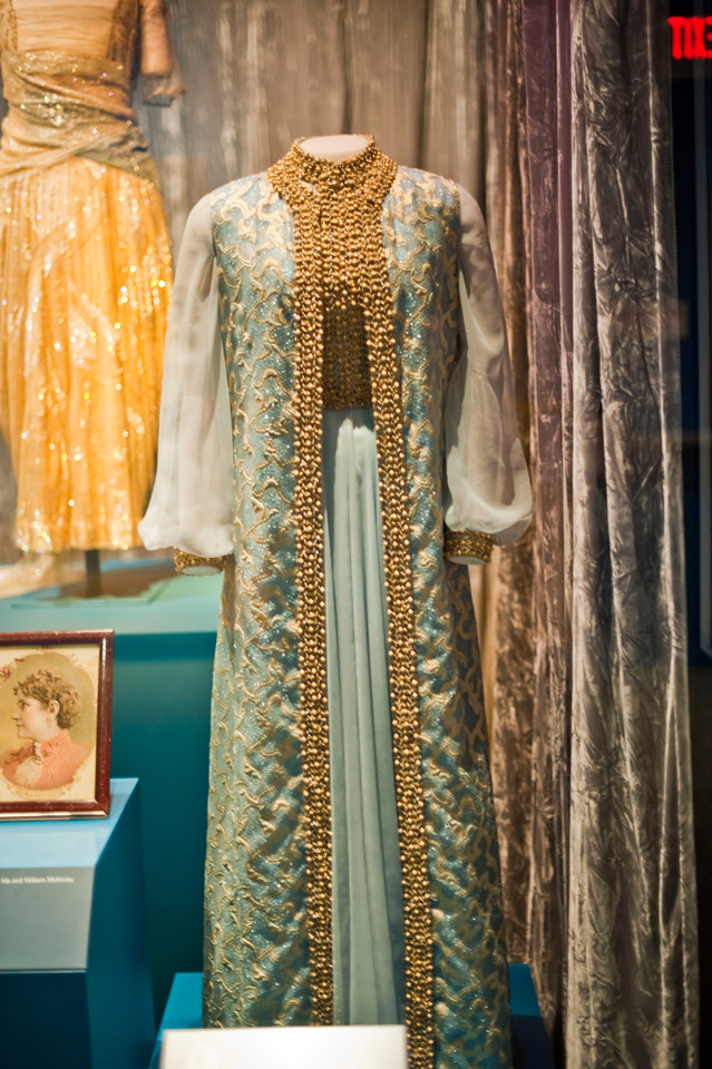 Rosalynn Carter wore this blue chiffon evening gown and sleeveless coat trimmed with gold embroidery and braid to the 1977 inaugural ball. She wore the same dress six years later when Jimmy Carter became governor of Georgia. It was designed by Mary Matise for Jimmae.