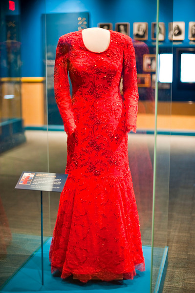 Laura Bush's inaugural ball gown from 2001. Made of red Chantilly lace and silk satin with crystal beading, the gown has long sleeves, a scoop neck and a full skirt. It was created by Dallas designer Michael Faircloth.