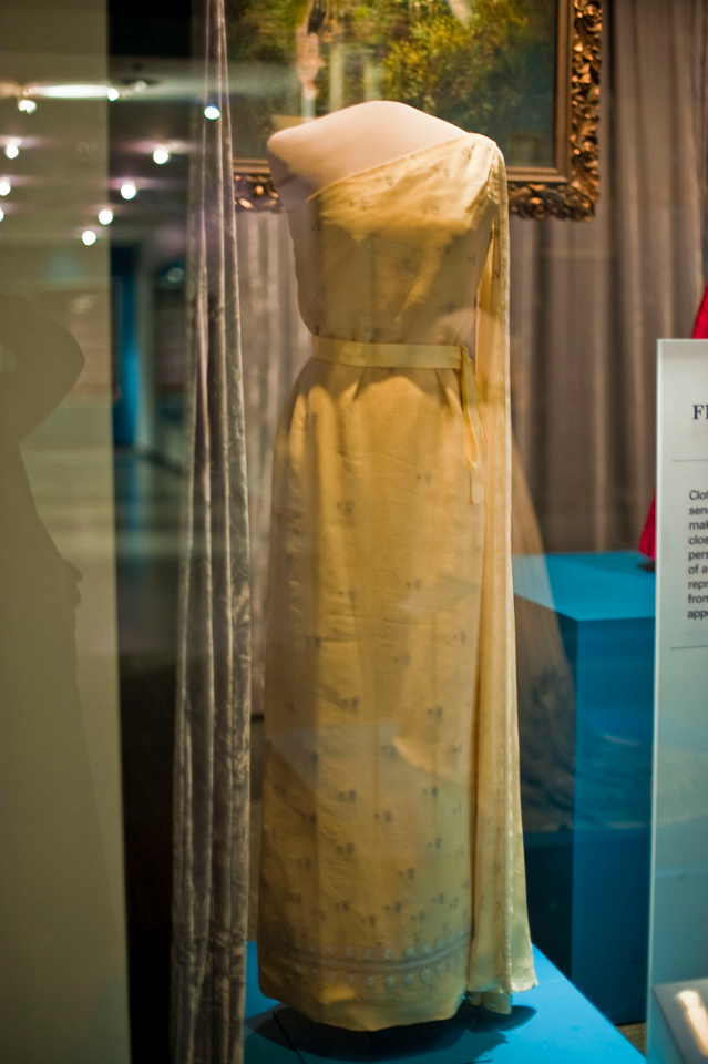 Nothing about First Ladies is complete without something of Jacqueline Kennedy's. Yellow silk evening gown with an overlay of crepe chiffon, worn in 1961 for the Kennedy administration's first state dinner, for Tunisian president Habib Bourguiba. Designed by Oleg Cassini. Fabulous.