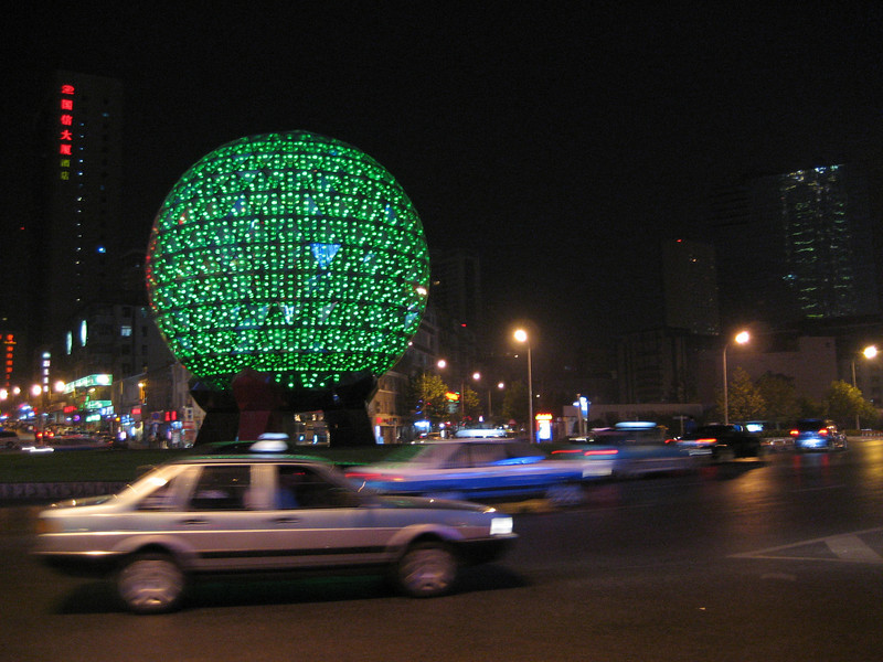 Dalian at night. This huge globe glows in different colors. Looks very impressive in the dark.