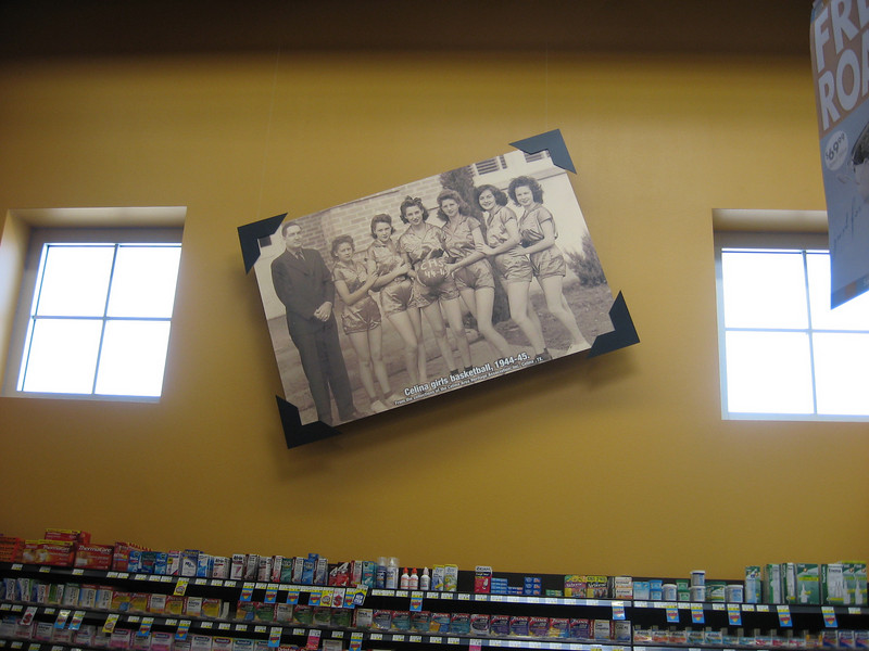 Photo (in a grocery store) of the Celina High School 1945 girls basketball team. David's mother, Ruth, is holding the ball.