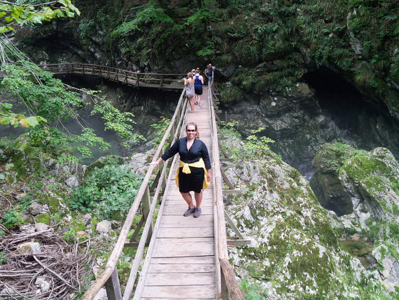 Courtney crosses the bridge over the river: At Vintgar Gorge