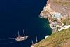 Yacht approaching port of Fira, Santorini, Greece