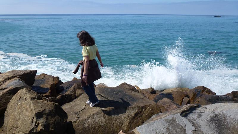 Diane walking on the breakwater.