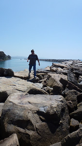 Mike walking on the breakwater.