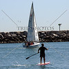Sailboat and stand up paddle surfing in Dana Point, California.