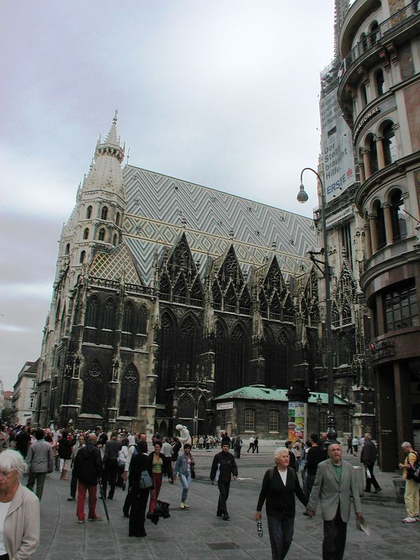 """Abigail and I broke from our group, and walked the several miles from the palace back to the heart of Vienna. Here, we have, after several photograph-free hours, arrived at the famous St. Stephen's Cathedral (""""Stephansdom""""). Built in 1147 AD, the gothic building with its 450' high steeple was the tallest building in Europe for centuries."""