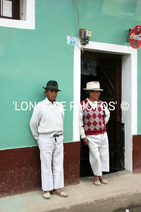 Men waiting for something to happen.  Ecuador.