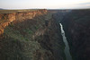 Sunrise striking the west rim of the Rio Grande Gorge outside of Taos, New Mexico. Standing on the bridge, the river is 640 below my feet.