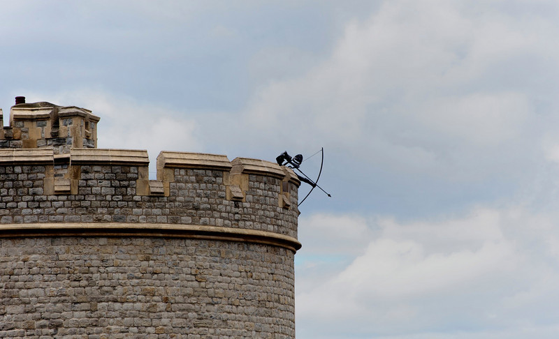 Archer in the Tower of London<br /> Ready to defend the Crown an archer is poised to fire across the moat