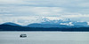 Olympic Mountains in snow with ferry boat crossing Elliott Bay.