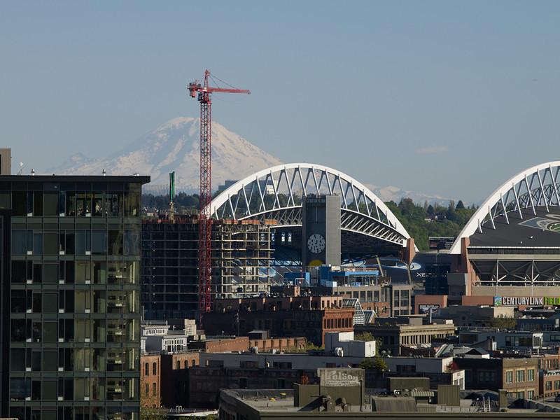 Mount Rainier and CenturyLink stadium in afternoon light