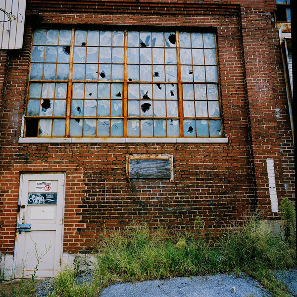 Broken window in abandoned factory