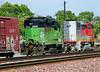 Parent railroad locomotives - Burlington Northern and Santa Fe - in premerger paint, parked just south of Merced platform.