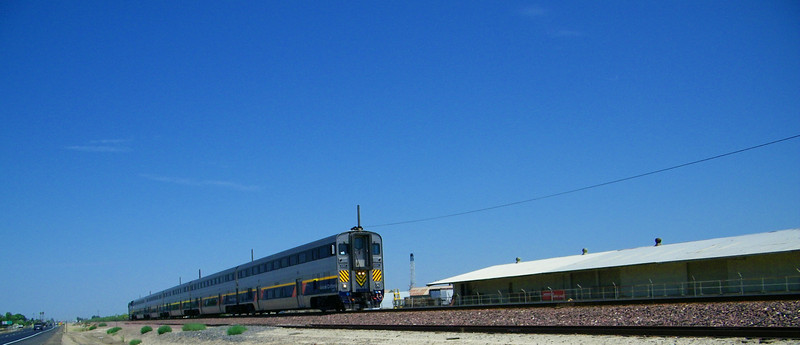 San Joaquin train 702 jams along highway 43 south of Wasco, running on time to Bakersfield.