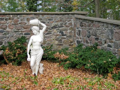 Statue and Stone Wall