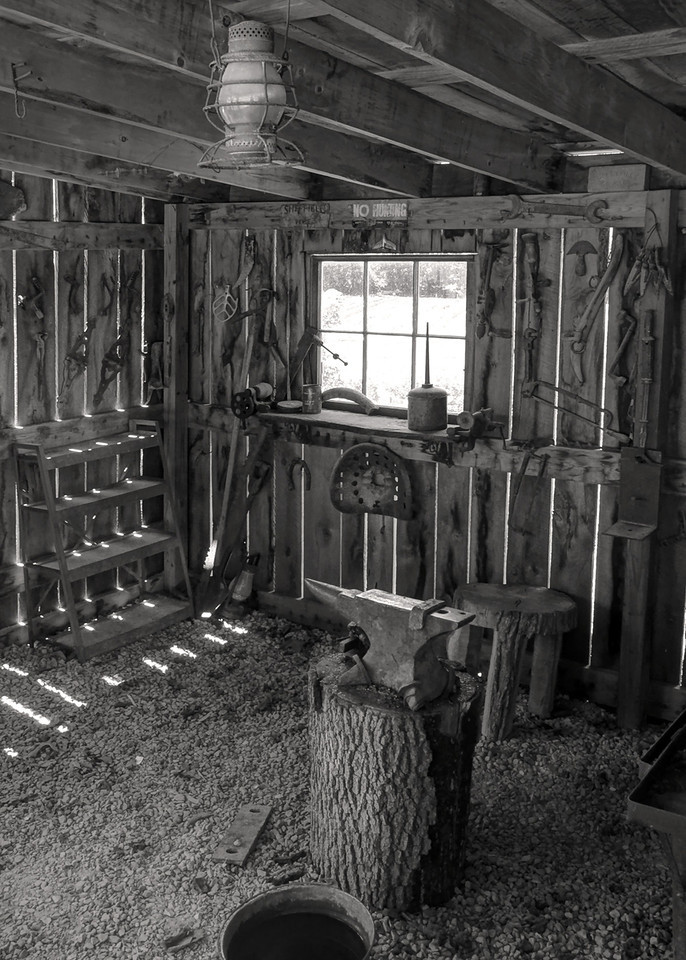 Interior of blacksmith shop, Bakersville, near Mansfield, Missouri. Black and white, high dynamic range version.