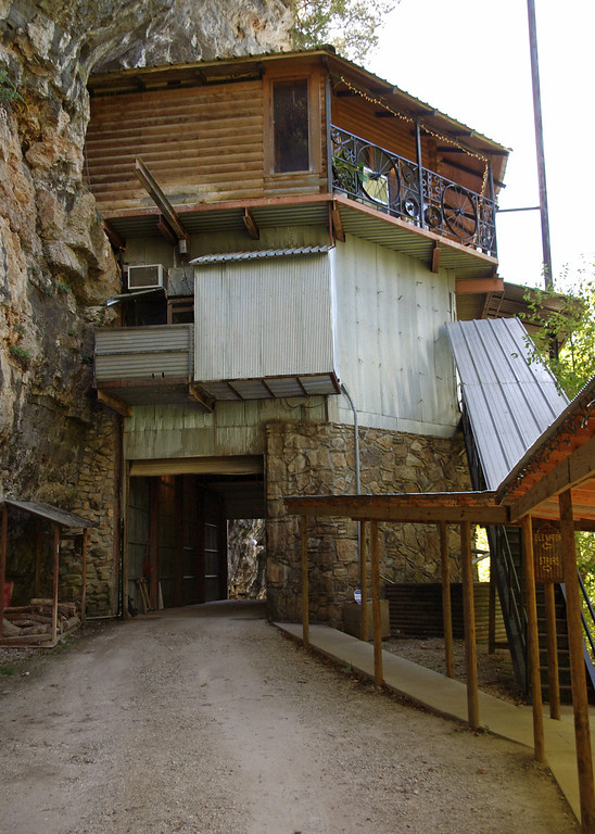 The entrance to the Cave Restaurant (formerly known as Caveman BBQ, near Richland, Missouri). You can take the stairs or an elevator. Not seen in this photo is an old iron spiral stairway going up the bluff to another entrance.