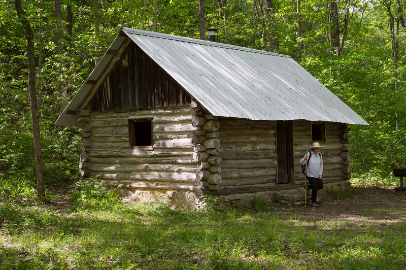 Log cabin in the woods is located on the banks of upper Bryant Creek. Cedar Gap Conservation Area near Mansfield, Missouri.