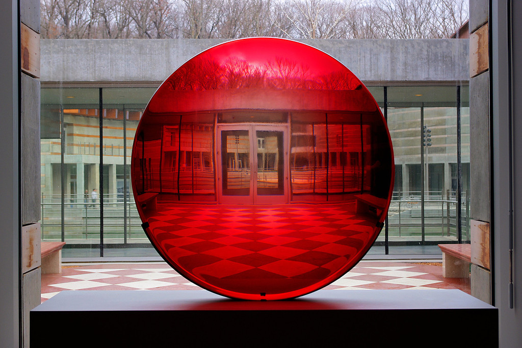 Red glass disc - an untitled work by by artist Fred Eversley. Crystal Bridges Museum, Bentonville, Arkansas.<br /> This is a HDR image made from combining 3 exposures.