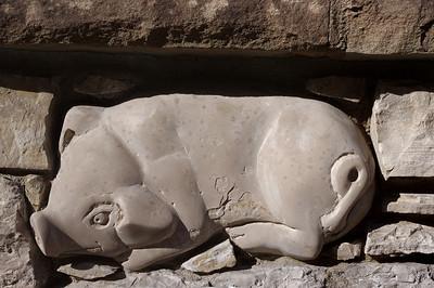 Piggie, carved into stone wall. Eureka Springs, Arkansas.