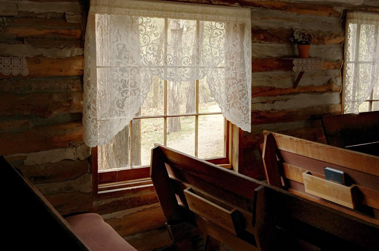 Church pews and window, Sycamore Log Church near Branson, Missouri.