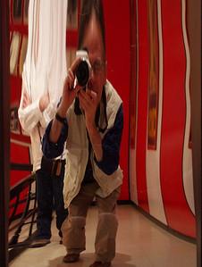 Conehead with camera. Fun house mirror; Joplin Museum Complex.
