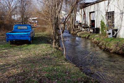 Blue Chevy truck and junk. Big Spring Park, Neosho, MO.