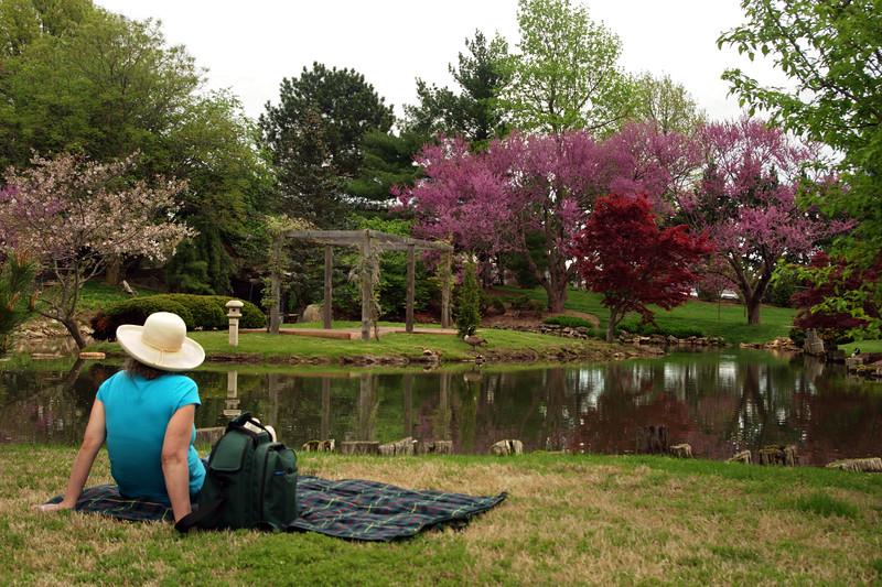 Rita picnicking beside the lake - Mizumoto Japanese Stroll Garden, Springfield, Missouri.