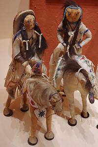 Osage dolls, figures on horseback. Museum of Native American History, Bentonville, Arkansas.