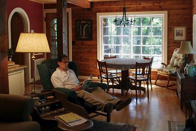 Gary, reading. Rick's log house.