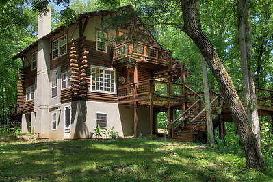 Rick's place on Spring Creek, about 2 miles up from Twin Bridges, Missouri. With help from friends, Rick built the house by hand from logs cut nearby.
