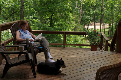 Rita reading on the deck at Rick's place.