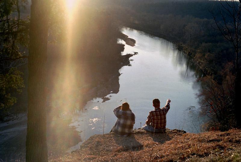 Rita and George on the edge of the bluffs over the Gasconade River, Rock Eddy Bluff B&B near Rolla, Missouri. Spring, 2001.