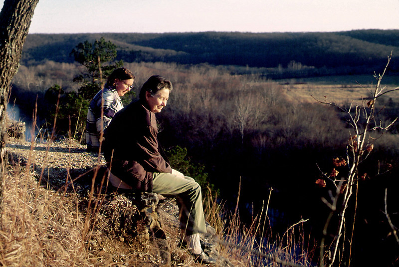 Norma and Rita sit on the cliff tops at Rock Eddy Bluff B&B near Rolla, Missouri. Spring, 2001.