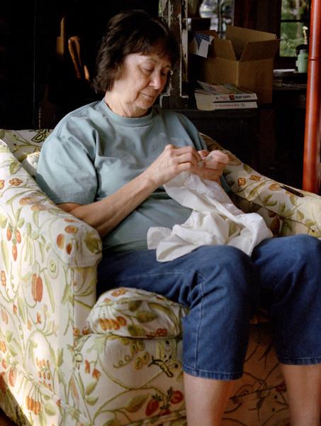 Norma Wright, sewing, Rock Eddy Bluff B&B near Rolla, MO. late summer 2002.