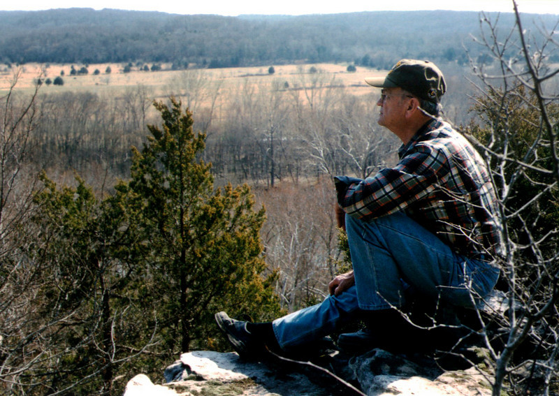 George on the edge of the bluffs; Rock Eddy Bluff B&B near Rolla, Missouri. Spring, 2001.